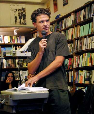 Author Dave Eggers talks to readers at The City Lights Bookstore in San Francisco, in this April 2, 2001 photo. Eggers donated his $1,500 speaking fee to a high school teacher, Eryn Osterhaus, who attended a lecture he gave last week.  Osterhaus says she plans to take her kids book shopping with the money, hoping a jaunt to the bookstore will build their interest in reading. (AP Photo/Susan Ragan) Photo: Susan Ragan, ASSOCIATED PRESS