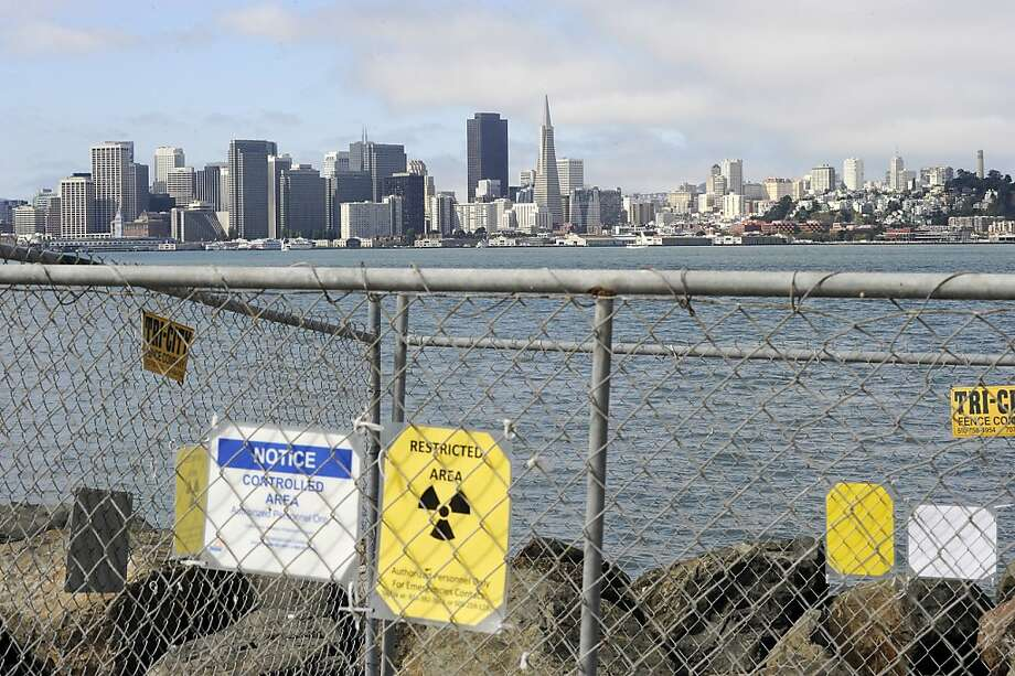 The San Francisco skyline viewed through a fence protecting one of Treasure Island's radioactive cleanup sites. Photo: Michael Short, The Bay Citizen