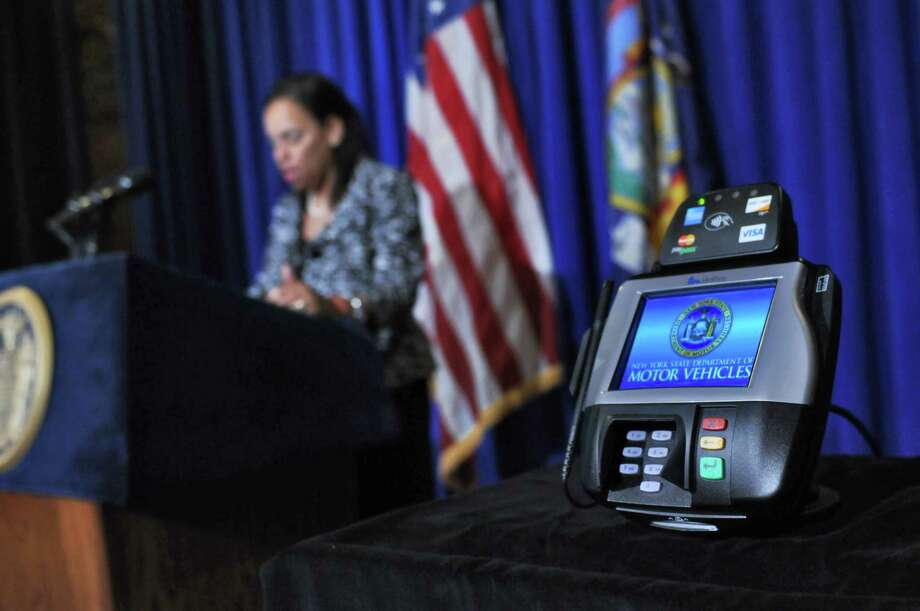 Mylan Denerstein, Counsel to Governor Andrew Cuomo, speaks about the Governor's initiative to to expand access to voter registration through the state's Department of Motor Vehicles, including using this electronic data entry device and by going online, during a press conference at the Capitol on Thursday Aug. 16, 2012 in Albany, NY.   (Philip Kamrass / Times Union) Photo: Philip Kamrass / 00018894A