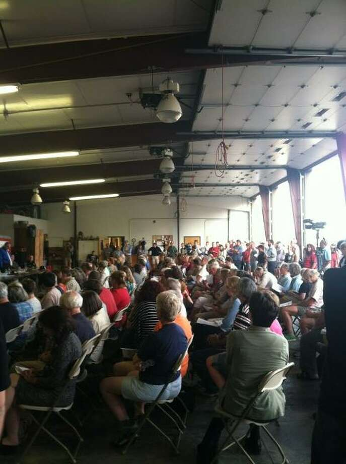 A crowd gathers Thursday evening at the West Ghent Volunteer Fire Department to ask questions of federal, state and local officiials about the Aug. 1-2 fire at the nearby TCI Inc. recycling plant. (Scott Waldman/Times Union)