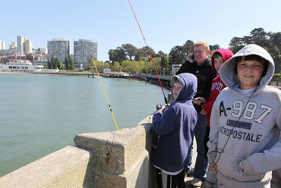 Fishing from a San Francisco Bay pier is free, with no license required, as the Bairs from Columbus, Ohio, discovered. Photo: Kat Wade, Special To The Chronicle