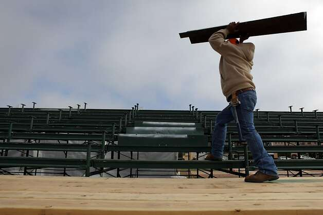Moises Valadez works to install steps in the bleachers at Marina Green. Photo: Carlos Avila Gonzalez, The Chronicle