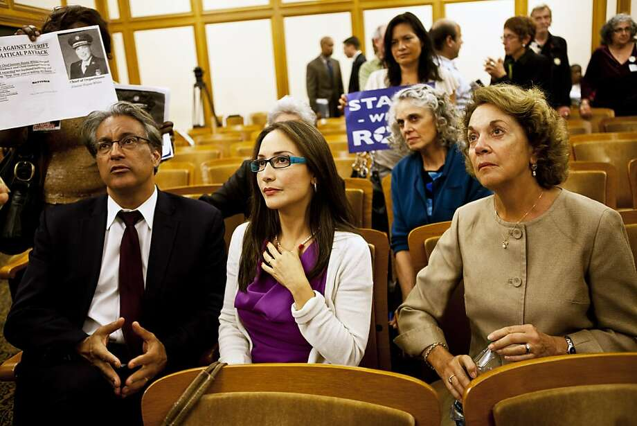 Ross Mirkarimi and Eliana Lopez sit in the Ethics Commission audience with Mirkarimi's mother, Nancy Kolman Ventrone. Photo: Sonja Och, The Chronicle