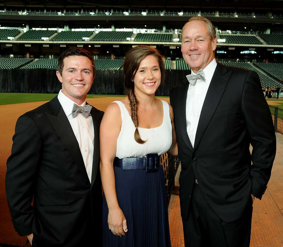 Garrett and Krystal Thompson with her father Jim Crane at the Astros Wives' Gala Thursday at Minute Maid Park. (Dave Rossman / For the Houston Chronicle)