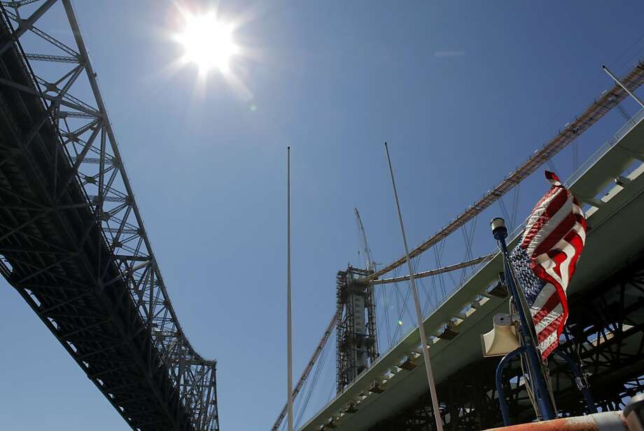 The weight of the 35,200-ton span has been shifted from temporary trestles to a single mile-long cable. Photo: Carlos Avila Gonzalez, The Chronicle