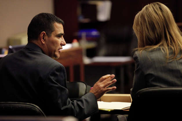 Former San Antonio Police Officer David Seaton, left, talks with his attorney, Carolyn Wentland, as he goes to trial on manslaughter charges before 226th District Court Judge Sid Harle, Tuesday, Nov. 16, 2010. He is accused of killing fellow police officer Robert Davis in a two-vehicle accident at the corner of Potranco and Hunt Lane in Nov. 28, 2008. Seaton rescinded his no contest plea on Nov. 12, 2009. It was the day he was to be sentenced. Investigators believed Seaton was driving more than 100 mph without his overhead lights on when he was responding to a low-priority shoplifting call and wrecked into a vehicle driven by Darrell Lampkin at that corner. As a result, SeatonÕs vehicle ran into Davis working another accident scene near the intersection. Davis suffered massive head injuries and died three days later on Dec. 1. JERRY LARA/glara@express-news.net Photo: JERRY LARA, SAN ANTONIO EXPRESS-NEWS / glara@express-news.net