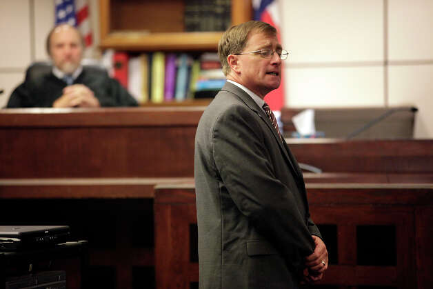 METRO -- Bexar County Prosecutor Charles Rich addresses the jury during opening statements in the trial of former San Antonio Police Officer David Seaton on manslaughter charges before 226th District Court Judge Sid Harle, Tuesday, Nov. 16, 2010. He is accused of killing fellow police officer Robert Davis in a two-vehicle accident at the corner of Potranco and Hunt Lane in Nov. 28, 2008. Seaton rescinded his no contest plea on Nov. 12, 2009. It was the day he was to be sentenced. Investigators believed Seaton was driving more than 100 mph without his overhead lights on when he was responding to a low-priority shoplifting call and wrecked into a vehicle driven by Darrell Lampkin at that corner. As a result, SeatonÕs vehicle ran into Davis working another accident scene near the intersection. Davis suffered massive head injuries and died three days later on Dec. 1. JERRY LARA/glara@express-news.net Photo: JERRY LARA, SAN ANTONIO EXPRESS-NEWS / glara@express-news.net