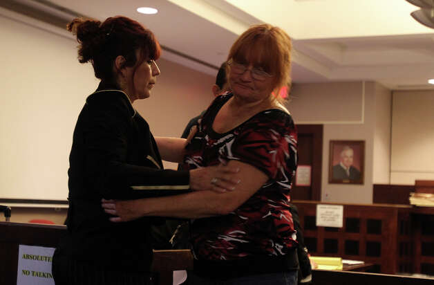 Slain Officer Robert Davis's mother-in-law, left, and mother, embrace as they trade places on the witness stand during the David Seaton trial at the Bexar County Justice Center 226th Judicial Court, Monday, November 29, 2010. Photo: JENNIFER WHITNEY, Special To The Express-News / special to the Express-News