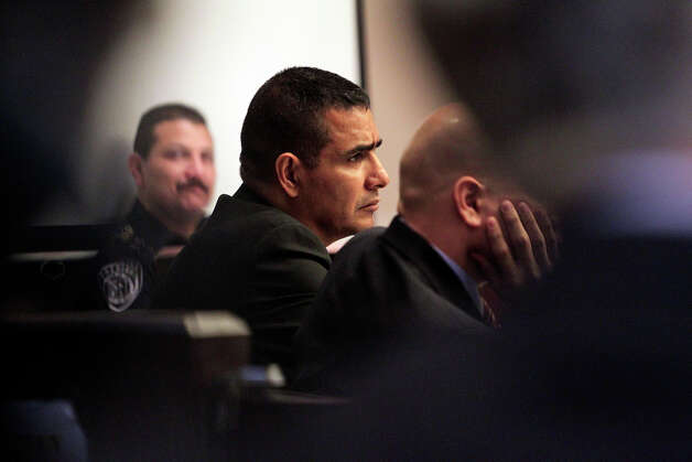 The defendent listens to arguments in the punishment phase of former SAPD Officer David Seaton in Sid Harle's 226th District Court on Dec. 1, 2010. Tom Reel/Staff Photo: TOM REEL, SAN ANTONIO EXPRESS-NEWS / © 2010 San Antonio Express-News