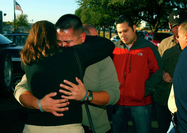 San Antonio police officer Roger Delarosa is comforted by a woman Tuesday afternoon Dec. 2, 2008 after Delarosa spoke at a news conference outside the West Side Sub-station about fellow officer Robert Davis who died Monday after being involved in an accident with another officer on Friday night. Delarosa attended the police academy with Davis and was also based at the sub-staion with him. Photo: WILLIAM LUTHER, SAN ANTONIO EXPRESS-NEWS / SAN ANTONIO EXPRESS-NEWS
