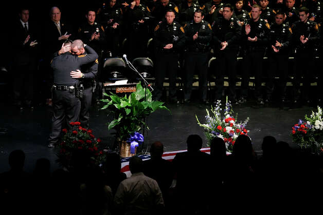 Police officer Roger De la Rosa (left) gets consoled by his colleague Jeffrey Martin during the funeral service for San Antonio Police officer Robert Davis at Bandera Road Community Church on December 4, 2008. De la Rosa, Martin and Davis were in the same academy training class together. Kin Man Hui/kmhui@express-news.net Photo: KIN MAN HUI, San Antonio Express-News / San Antonio Express-News