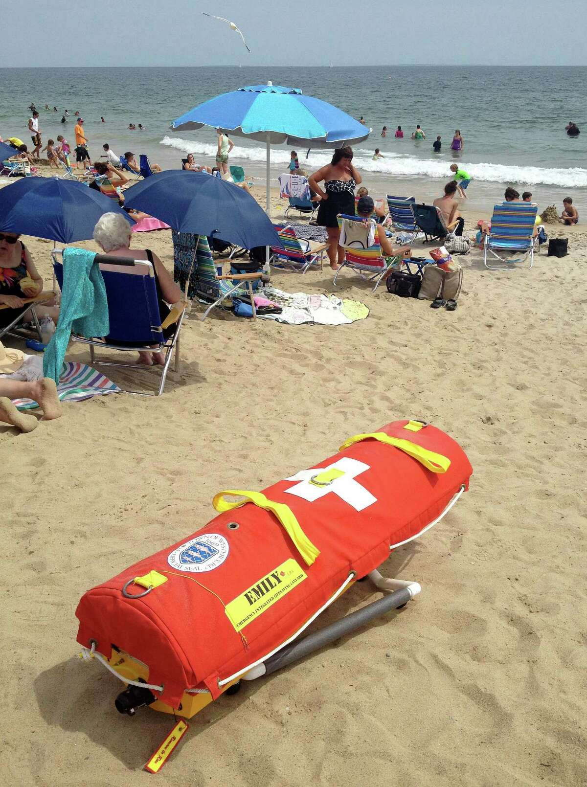 In this Wednesday, Aug, 8, 2012 photo, EMILY, (Emergency Integrated Lifesaving Lanyard) a remote-controlled battery powered lifesaving device, sits on Old Town Beach in Westerly, R.I. EMILY is a small watercraft fitted with a flotation device and can go up to 22 mph, allowing it to get to people more quickly, and in some cases more safely, than any human.