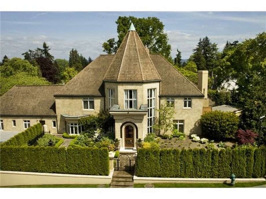 This opulent mansion, 1900 Shenandoah Drive E., in Broadmoor, was built in 1931 but extensively overhauled in 2008. Now, it's for sale for $4.995 million. The 10,095-square-foot house has six bedrooms and eight bathrooms, including a guest quarters with its own entrance, three fireplaces, a two-story foyer, arched doorways, wrought-iron railings, French doors and a weight room on a 21,425-square-foot manicured lot with a fountain and sport court. Photo: Courtesy Moira Holley/Realogics Sotheby's International Realty