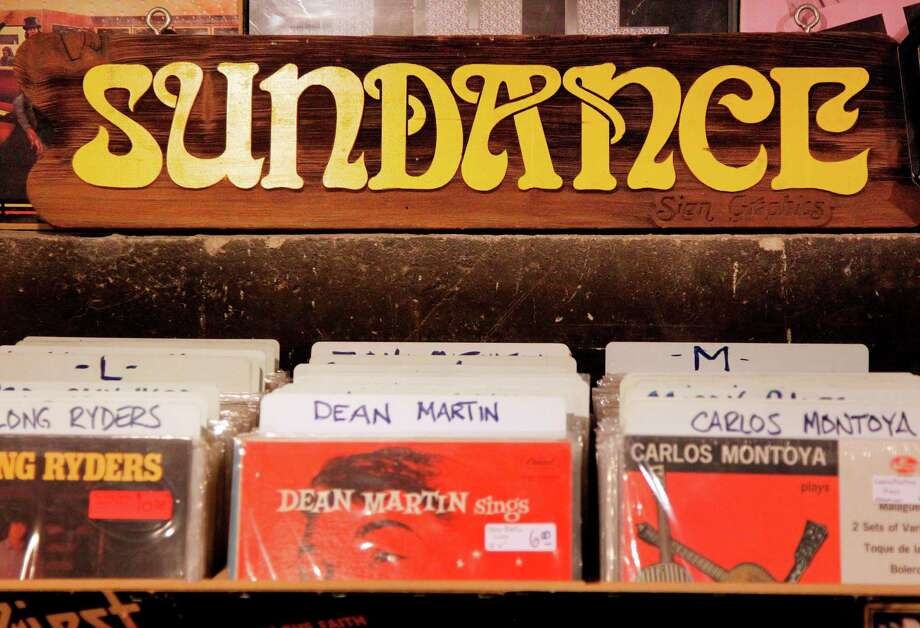 """Sundance"" sign is on display above records at Sig's Lagoon on Tuesday, Aug. 7, 2012, in Houston. Bobby Bradford was living in Houston when his best friend Sanford Randinsky was shot and killed in HPD raid. He left town and settled in San Marcos where he set up a record store called Sundance, which became one of the longest-running independent stores in Texas. Earlier this year he finally decided to close the store, despite having thousands of LP's. Tomas Escalante, former employee, offered his store Sig's Lagoon to open a Sundance annex. ( Mayra Beltran / Houston Chronicle ) Photo: Mayra Beltran / © 2012 Houston Chronicle"
