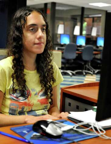 Camila Bortolleto, 24, who is a leader in the Connecticut Students for a Dream movement, works on a computer in the Ruth Haas Library at Western Connecticut State University in Danbury, Thursday, Aug. 16, 2012. Photo: Michael Duffy