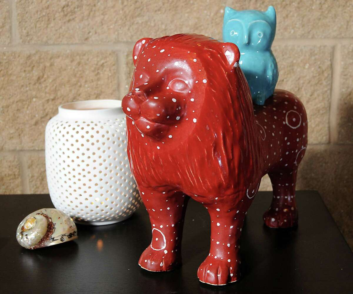 Certified feng shui consultant Gina Castalleno says the statuary of the lion with the owl on its back in the entry hallway of her loft represents strength with wisdom. Also, lion is the protector of the home. Stanford Lofts near Minute Maid Park Friday Aug. 03, 2012.(Dave Rossman/For the Chronicle)