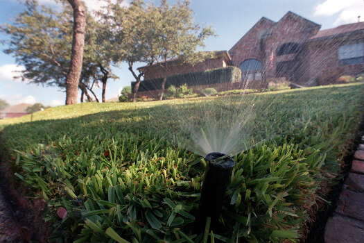 Water lawns early in the morning during the hotter summer months. Otherwise, much of the water used can simply evaporate. Photo: Express-News File Photo / SAN ANTONIO EXPRESS-NEWS