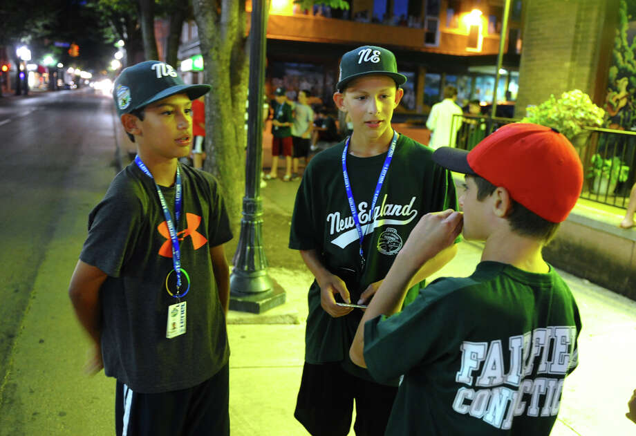 New England players Michael Ghiorzi, left, and Henry Prestegaard, right, chat with Michael Pandazzo, 12, outside at a party for the New England team, which was held at the Bullfrog Brewery in downtown Williamsport, Penn. on Thursday August 16, 2012. Randazzo is a player on the 11's District Fairfield American team, which is one level lower than the team playing in the series. Photo: Christian Abraham / Connecticut Post
