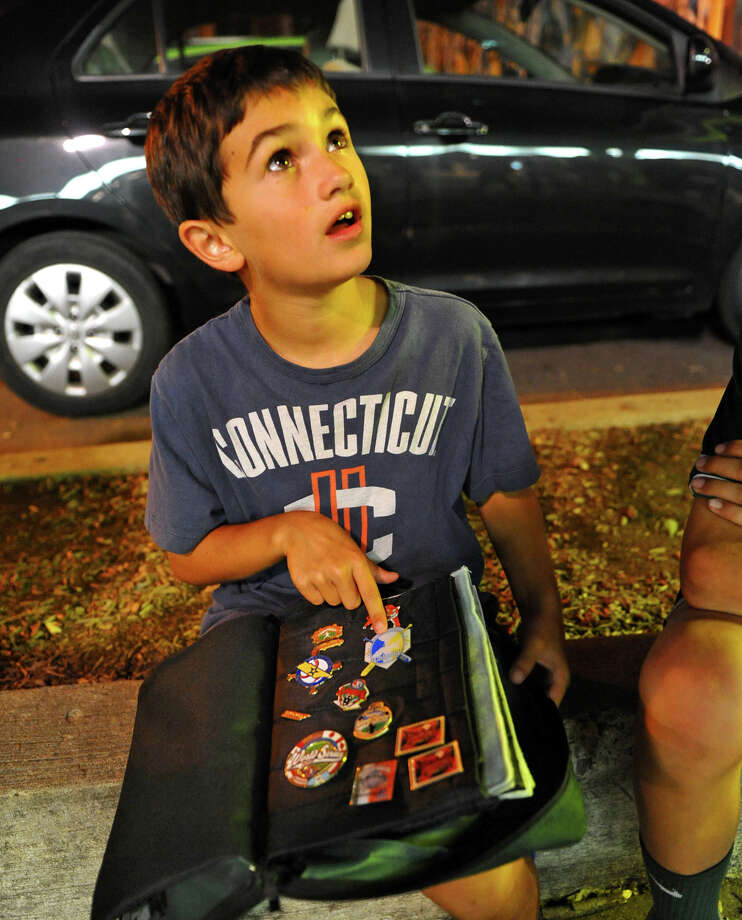 Luciano Paoletta, 8, shows off his growing pin collection at a party held for the New England team, which was held at the Bullfrog Brewery in downtown Williamsport, Penn. on Thursday August 16, 2012. Luciano, whose brother Biagio is on the team, just started collecting the pins which is a popular pastime at the series. Photo: Christian Abraham / Connecticut Post
