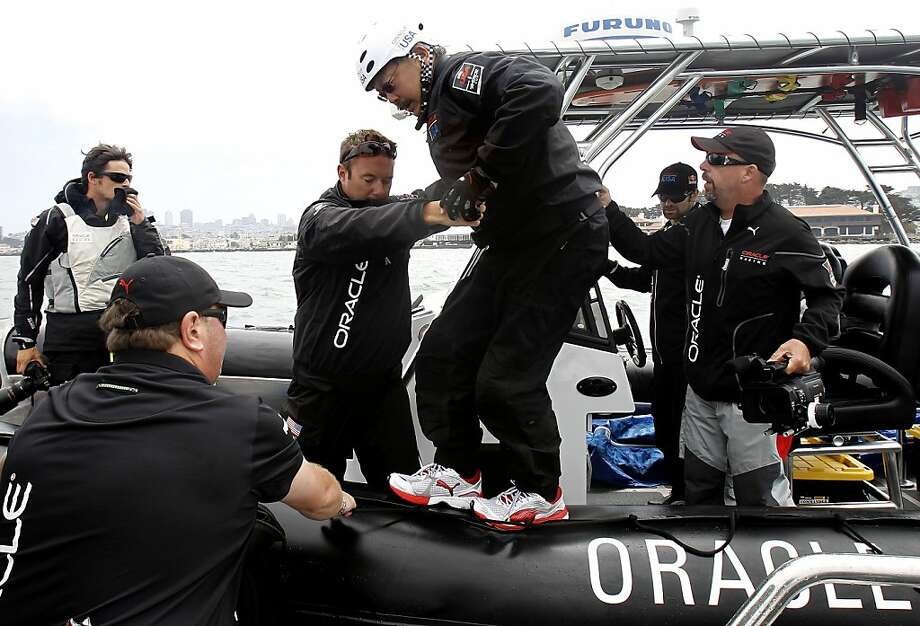 San Francisco Mayor Ed Lee, on Wednesday August 15, 2012, gets a helping hand as he climbs  aboard the Oracle Team USA America's Cup 45 number 5 boat, as the team practices in preparation for the America's Cup World Series races on San Francisco Bay, Calif. Photo: Michael Macor, The Chronicle