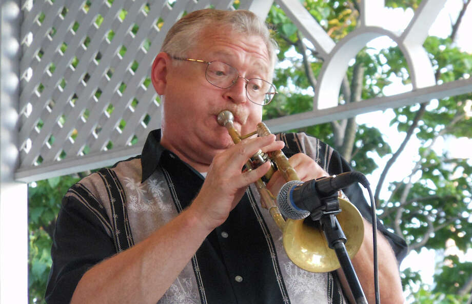A trumpeter with Uptown Jazz Band belts out out a swing number at Sherman Green gazebo Thursday night. Photo: Mike Lauterborn / Fairfield Citizen contributed