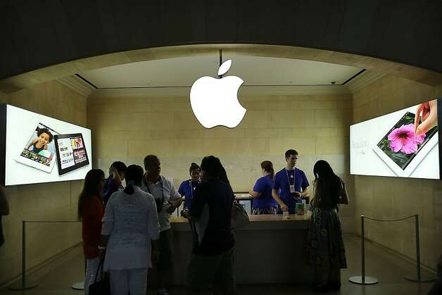 Customers walk through the Apple store in Grand Central Terminal last month in New York. The stock rose Friday. Photo: Spencer Platt, Getty Images