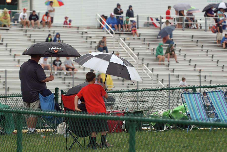 Light rain falls during the Mexico Vs Canada game at the Little Leauge World Series in South Williamsport, Penn. on Friday August 17, 2012. Photo: Christian Abraham / Connecticut Post