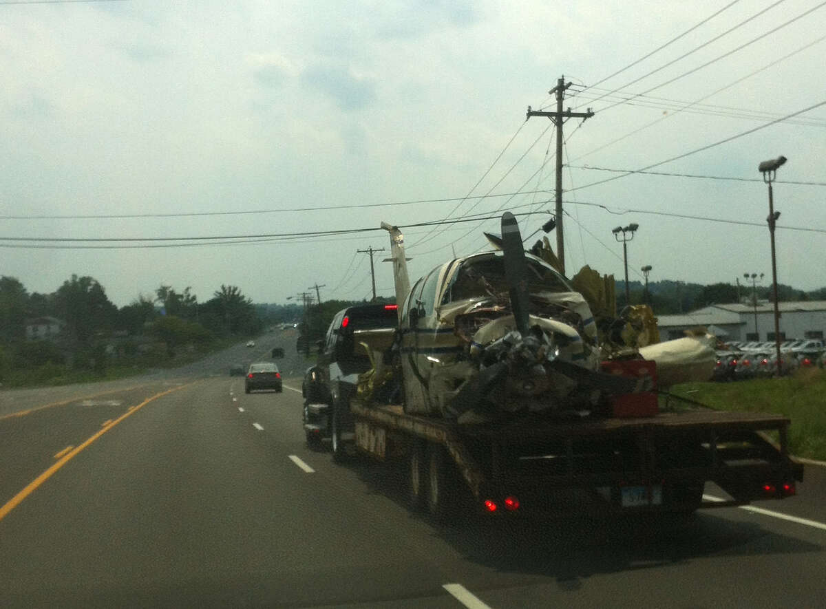 The single-engine Beechcraft Bonanza that crashed in Clifton Park is towed down Route 9 on Friday, Aug. 17, 2012.
