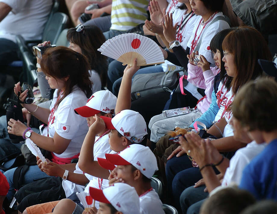 Little leaguers from Japan sit in the stands during opening ceremonies at the Little Leauge World Series in South Williamsport, Penn. on Thursday August 16, 2012. Photo: Christian Abraham / Connecticut Post