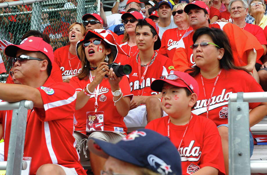 Canadian fans cheer the team on as they play Mexico, at the Little Leauge World Series in South Williamsport, Penn. on Friday August 17, 2012. Photo: Christian Abraham / Connecticut Post