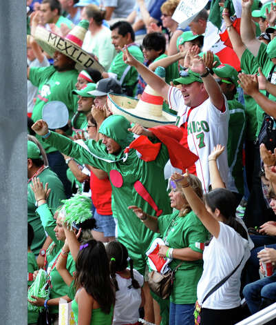 Mexico fans cheer as the team brings in two runs in play against Canada, at the Little Leauge World Series in South Williamsport, Penn. on Friday August 17, 2012. Photo: Christian Abraham / Connecticut Post