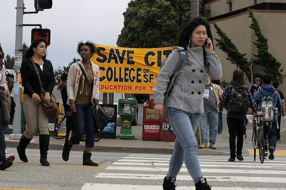 Students cross Phelan Street at the City College of San Francisco on Wednesday, August 15, 2012, in San Francisco, Calif.