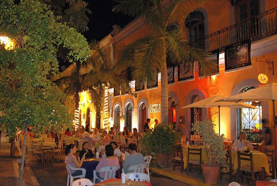 Restaurants move their tables into the street at night in Plazuela Machado. Photo: Christine Delsol