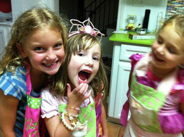 Hazel Britton Dansby, center, lost a tooth during her sleepover with guests Alexis Shor, left, and Maddie Schneider. Photo: Nicki Britton