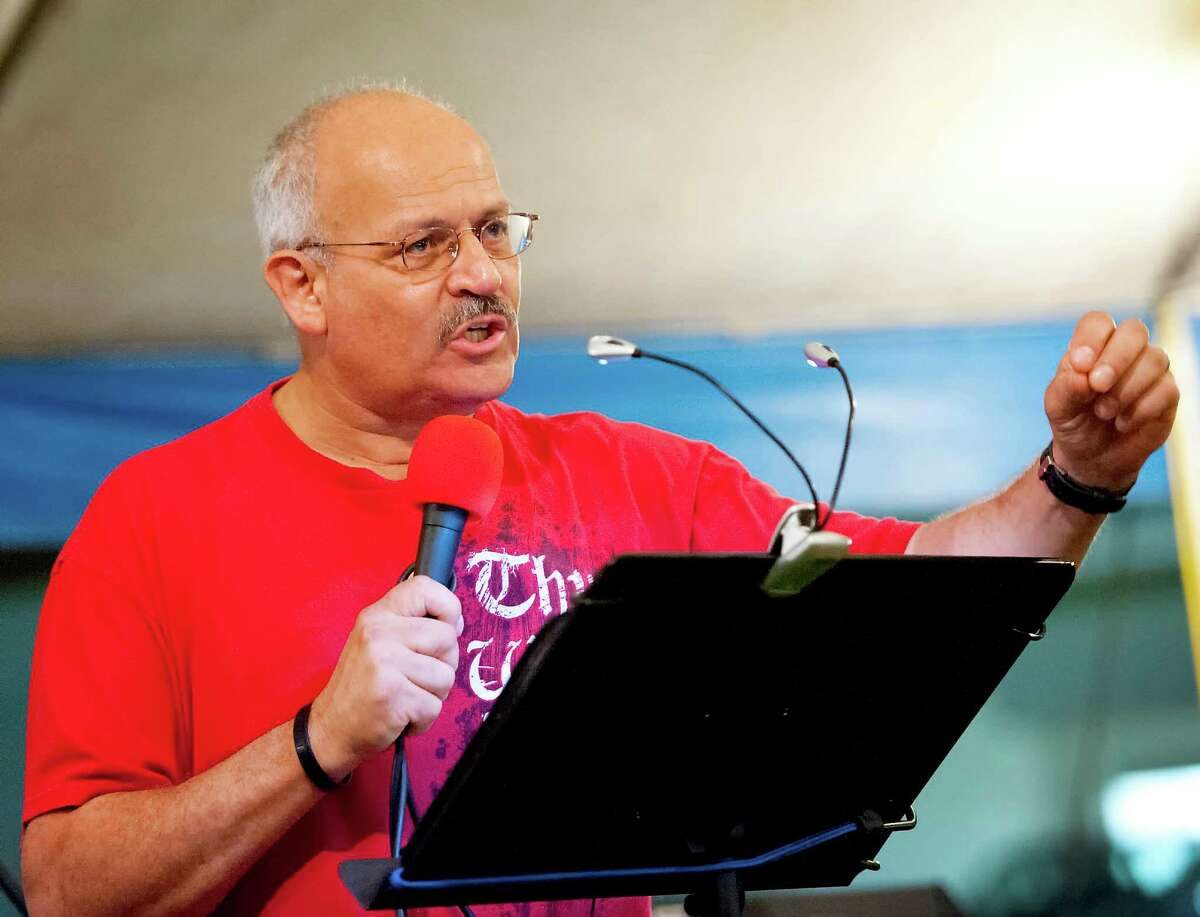 Pastor Jorge Garcia of the Flowing Spirit Ministries speaking to the people attending the tent revival in Shelton, CT on Thursday August 16th 2012.
