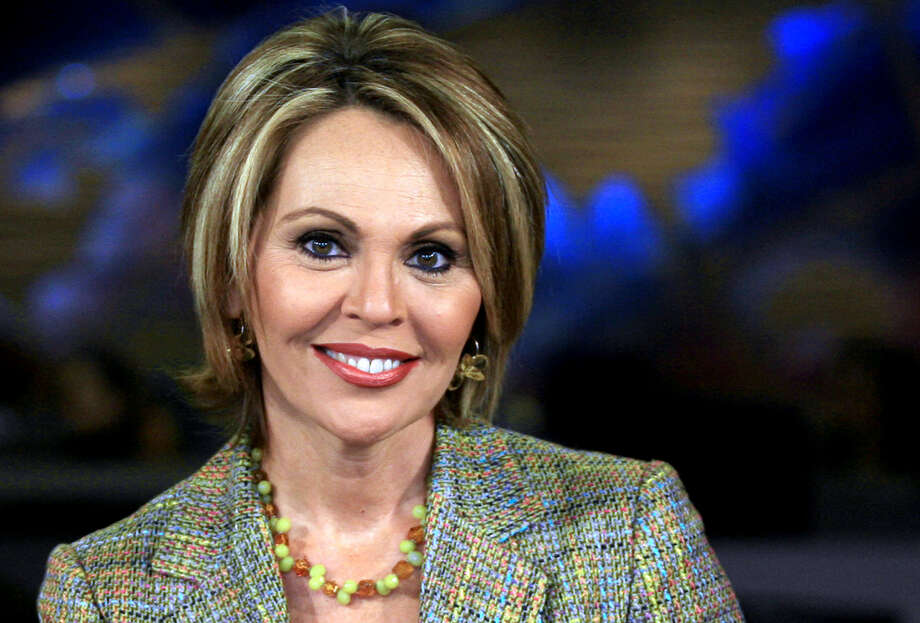 """FILE - In this March 31, 2006 file photo, Maria Elena Salinas poses at the Univision studio in Miami. Just a month after Forbes Magazine recognized the Hispanic television market as """"the next media jackpot,"""" some are complaining that Hispanic media aren't getting a fair share of attention from the political realm. (AP Photo/Luis M. Alvarez, File) Photo: Luis M. Alvarez, Associated Press / AP"""