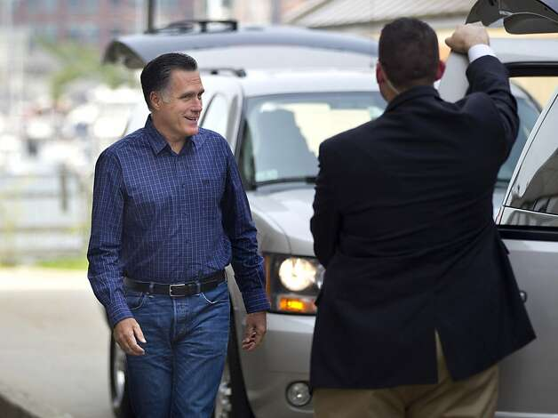 Republican presidential candidate, former Massachusetts Gov. Mitt Romney leaves his headquarters in Boston, Friday, Aug. 17, 2012.  (AP Photo/Evan Vucci) Photo: Evan Vucci, Associated Press