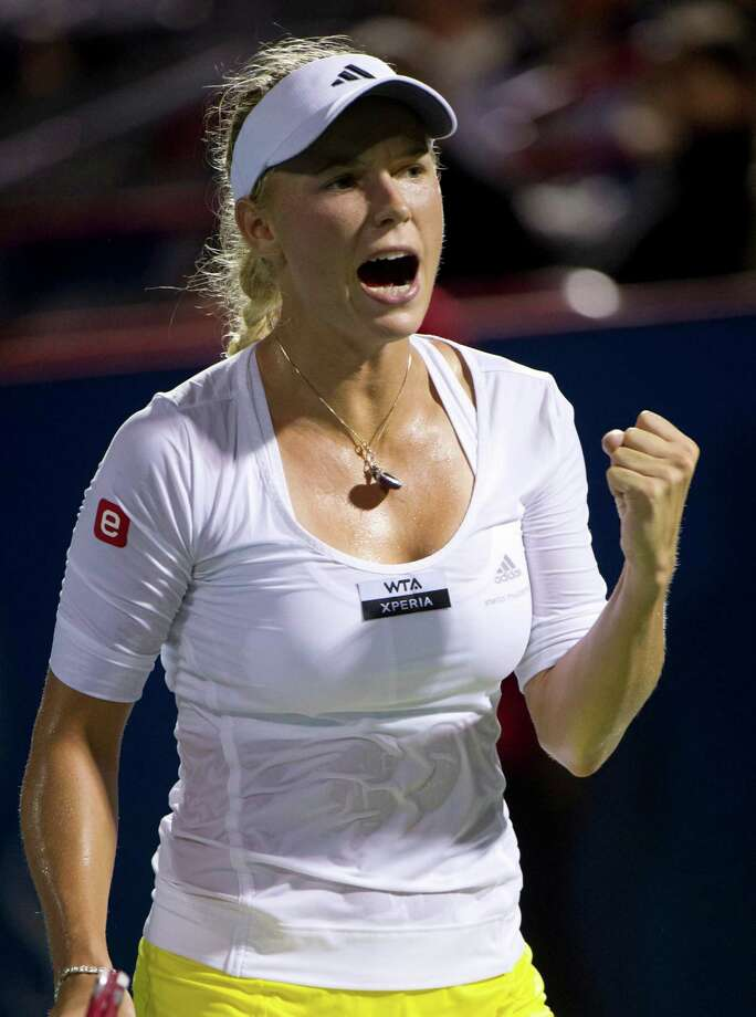 Caroline Wozniacki, from Denmark, celebrates a point over Canada's Aleksandra Wozniak during a quarterfinal of the Rogers Cup women's tennis tournament, Saturday, Aug. 11, 2012, in Montreal. (AP Photo/The Canadian Press, Paul Chiasson) Photo: Paul Chiasson, Associated Press / The Canadian Press