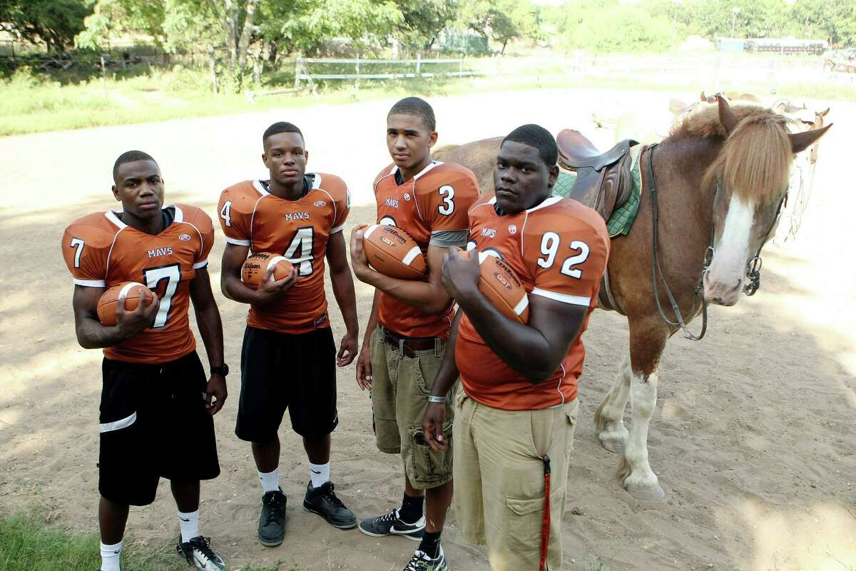 Madison High School football players Marquis Warford (7) Byron Daniels, (4) Dannon Cavil (3) and Vincent Taylor (92) at Turkey Creek Stables.