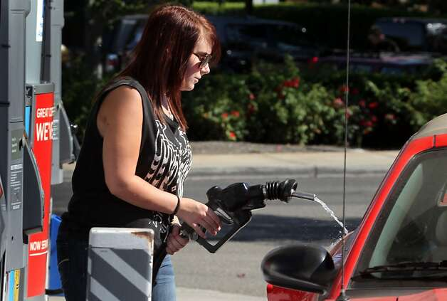 Rachel Lamke of San Ramon fills up her tank at a Chevron station. Refineries increased production after the Aug. 6 Richmond fire to compensate for an anticipated shortage, which did not materialize. Photo: Lance Iversen, The Chronicle / SF