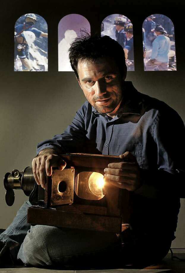 Ben Wood with an 1800s projector. In the background is his work marking the 10th anniver-sary of Sept. 11. Photo: Michael Macor, The Chronicle