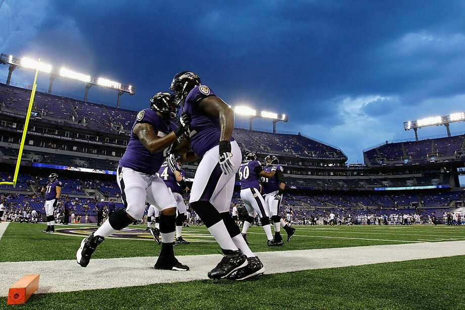 Ramon Harewood #70 and Kelechi Osemele #72 of the Baltimore Ravens block each other during warm ups before the start of the Ravens game against the Detroit Lions at M&T Bank Stadium on August 17, 2012 in Baltimore, Maryland. Photo: Rob Carr, Getty Images