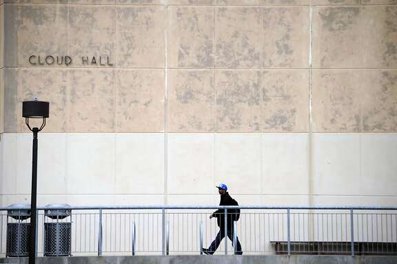 A student is seen between classes outside Cloud Hall at City College of San Francisco on Friday August 17th, 2012