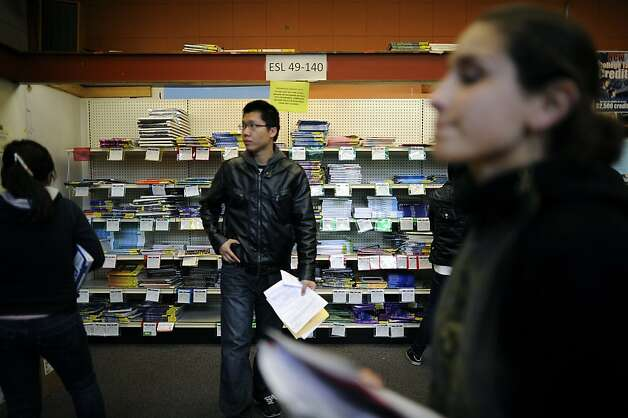 Students shop for textbooks at City College of San Francisco, which the state says must cut spending sharply. About 50,000 students rely on the school for higher education or to learn English and help develop careers. Photo: Michael Short, Special To The Chronicle