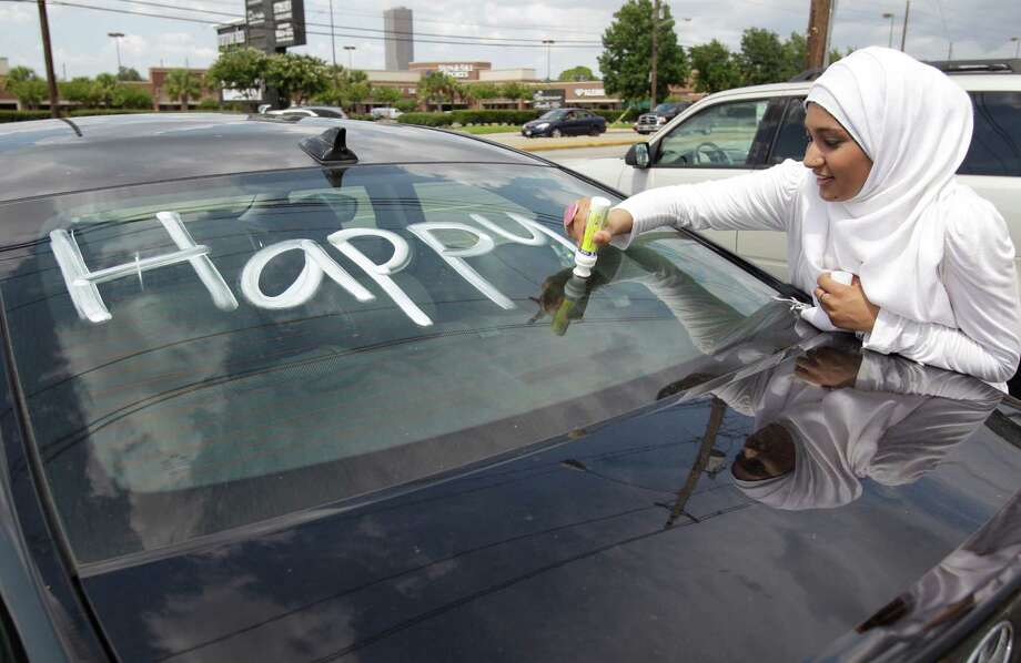 Sabeen Rauf, a member of Crescent Youth, hopes an initiative to decorate vehicles will help educate  non-Muslims about the holiday Eid al-Fitr and her faith. Photo: Melissa Phillip / © 2012 Houston Chronicle