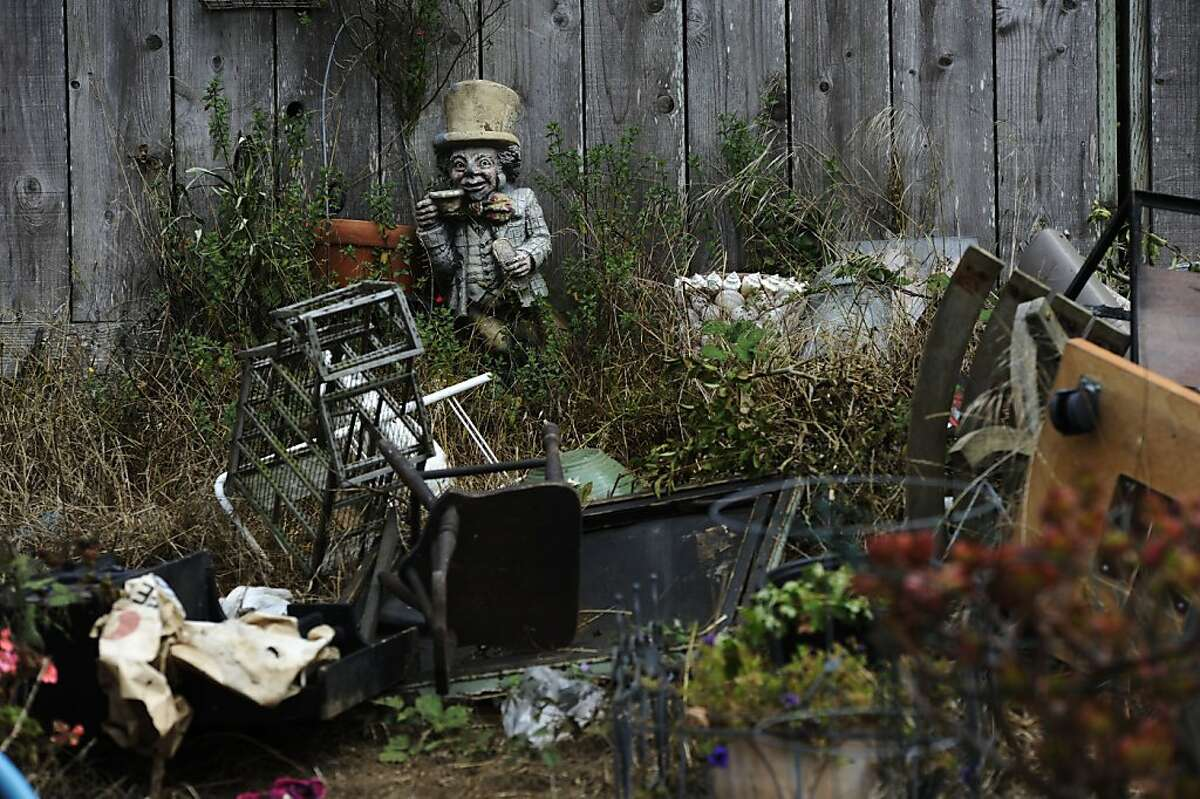 Items removed from the house after the fire are photographed outside the house on Friday, Aug 17, 2012 in San Francisco, Calif.