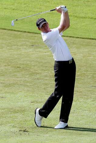 Jimmy Walker hits from the ninth fairway during the second round of the Wyndham Championship golf tournament in Greensboro, N.C., Friday, Aug. 17, 2012. (AP Photo/Gerry Broome) Photo: Gerry Broome, Associated Press / AP