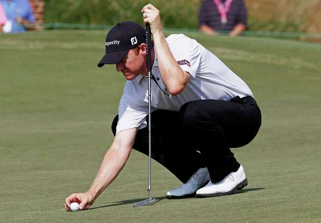 Jimmy Walker lines up a putt on the ninth green during the second round of the Wyndham Championship golf tournament in Greensboro, N.C., Friday, Aug. 17, 2012. (AP Photo/Gerry Broome) Photo: Gerry Broome, Associated Press / AP