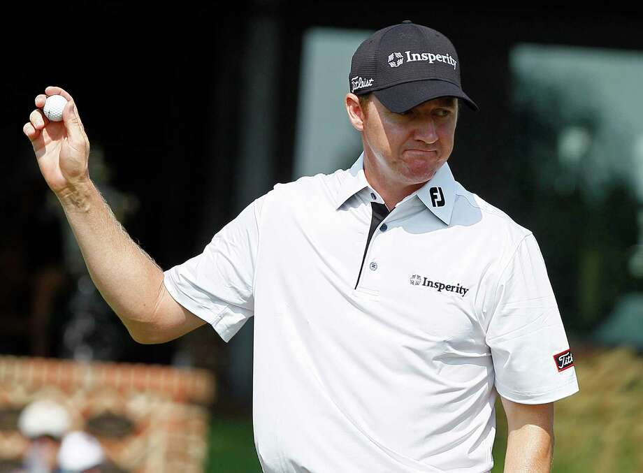 Jimmy Walker reacts following a putt on the ninth green during the second round of the Wyndham Championship golf tournament in Greensboro, N.C., Friday, Aug. 17, 2012. (AP Photo/Gerry Broome) Photo: Gerry Broome, Associated Press / AP