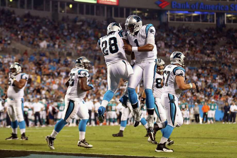 Cam Newton (1) celebrates with teammate Jonathan Stewart after the running back scored a touchdown. Photo: Streeter Lecka, Getty Images / 2012 Getty Images
